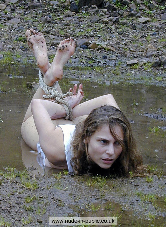 tied naked in mud