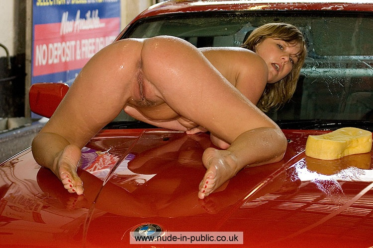 Naked women wash car
